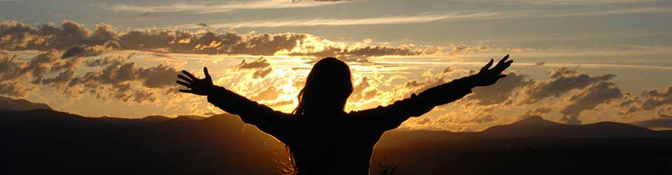 woman-sunrise-arms-out-960x250-960x250